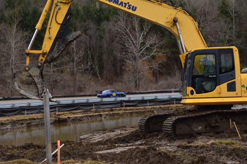 April 2015: A-Paddock will have an attractive retention pond behind the newly placed Big Bend inside guardrail