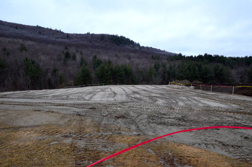 April 2015: The beginnings of the all-new Hospitality area overlooking the Right-hander. This is looking southwest, toward No Name Straight.