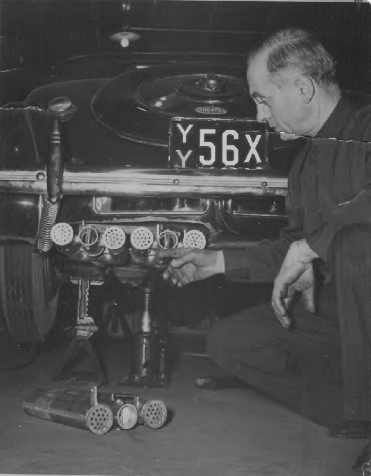 Perry Fina installing custom exhaust system on vintage Bugatti
