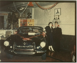 Perry and Lillian Fina with the '54 Fina Sport in the Norwalk showroom Christmas season 1960