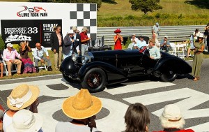 "With Honored Guests Sir Stirling Moss and Jochen Mass looking on (left), the Ralph Lauren-owned 1930 ""Count Trossi"" Mercedes SSK is awarded Best of Show honors (Photo by Casey Keil/Lime Rock Park)"