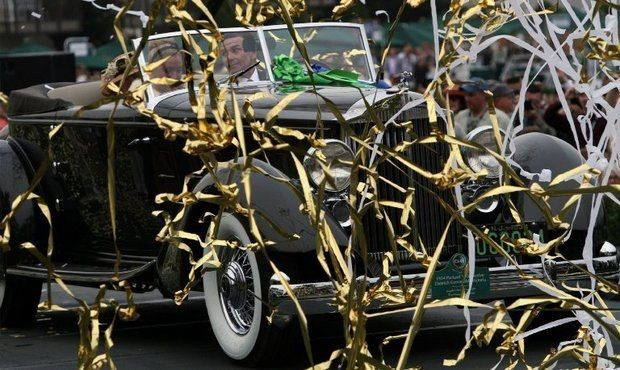 Joseph Cassini in his 1934 Packard 1108 Twelve Dietrich Convertible Victoria after winning Best of Show at the Pebble Beach Concours d'Elegance in Pebble Beach, CA. in 2016.. (Photo Bob Chamberlin/Los Angeles Times/MCT)