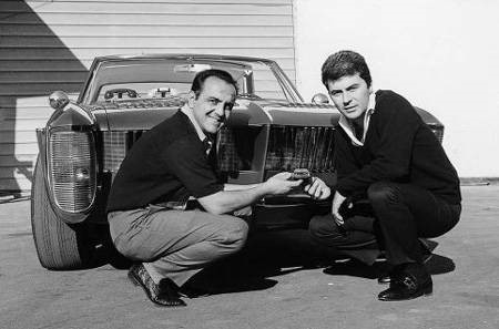George Barris and James Darren pose in front of the Villa Riviera.