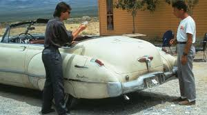 "Dustin Hoffman & Tom Cruise in a scene from ""Rain Man"" with 1949 Buick Roadmaster"