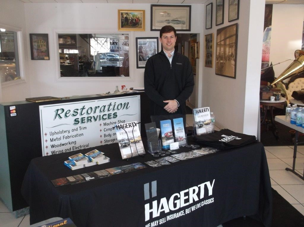 Hagerty Regional Manager Will Corr set up at Dragone's Westport showroom (Photo New England Auto Museum)