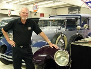 Bestselling Author Clive Cussler with his automobile collection Photo G.P. Putnam's Sons