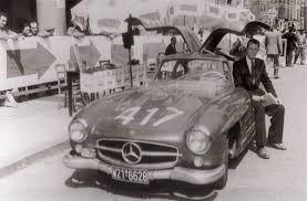 John Fitch with Mercedes 300SL which he drove to 5th Overall in the 1955 Mille Miglia.  Archive Photo
