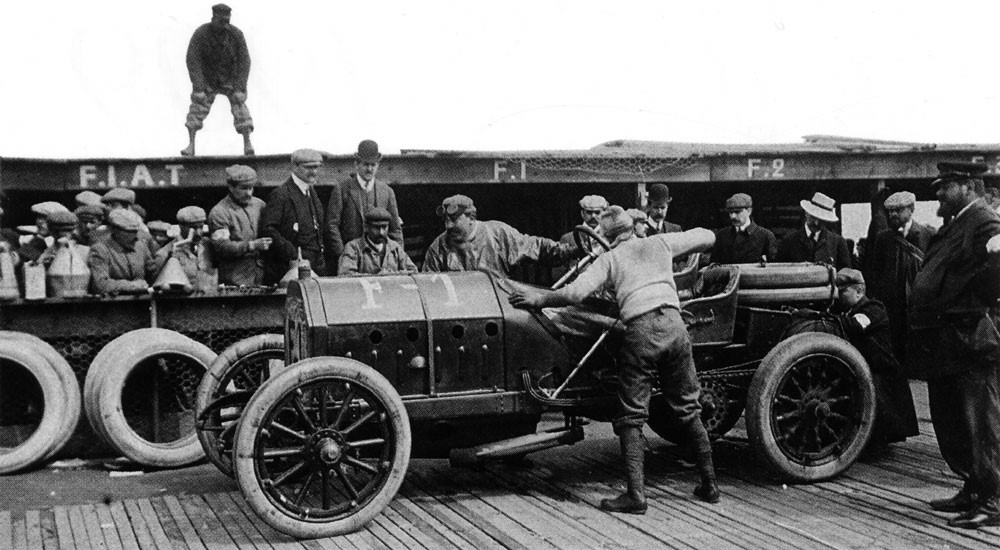 Vincenzo Lancia and mechanic and future superstar driver of the 20's Pietro Bordino, pushing their Fiat F1 in the pits