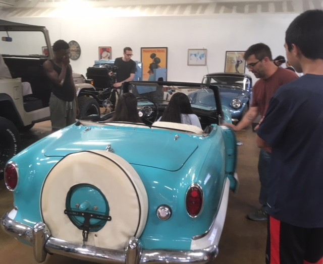 BMHS Auto Technology class students get to sit in a vintage Nash Metropolitan recently upgraded with a modern Mazda Miata engine