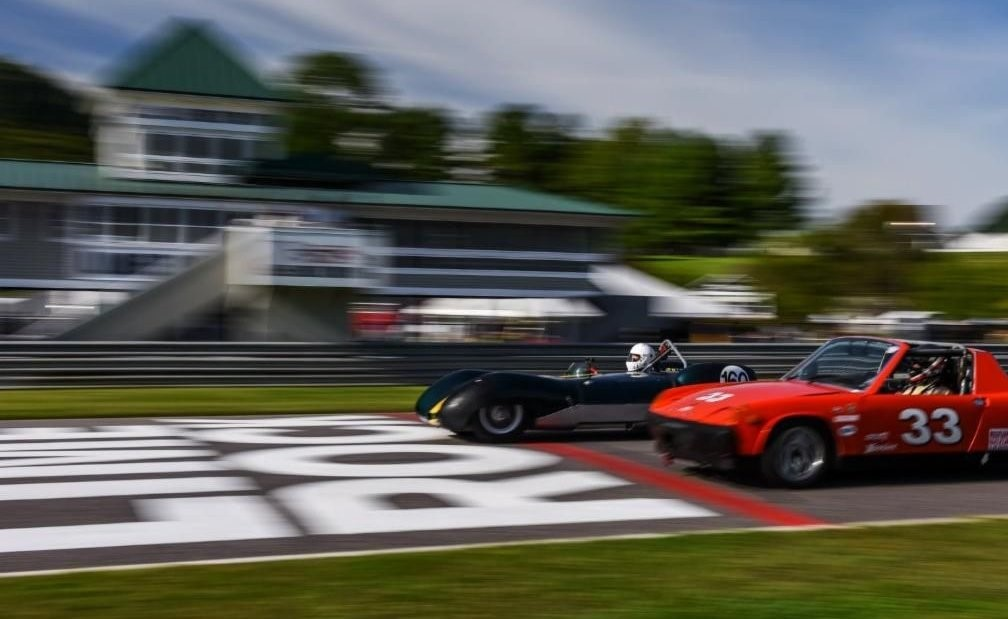 Andy Williams of Stamford, Conn., in a 1958 Lotus 11 (left) and Greg Amy of Middletown, Conn., in a 1974 Porsche 914-4 (right). The two raced in Group One: A Sporting Mixture — Small bore sports and sports/racers. Photo: Lime Rock Park.